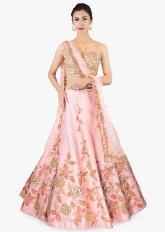Pink raw silk lehenga paired with net dupatta and an unstitched embroidered blouse