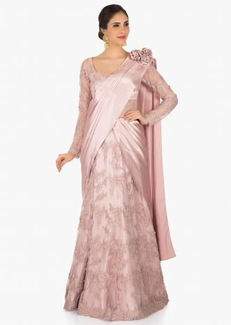 Pink embroidered net gown featuring the beautiful cowl drape only on Kalki