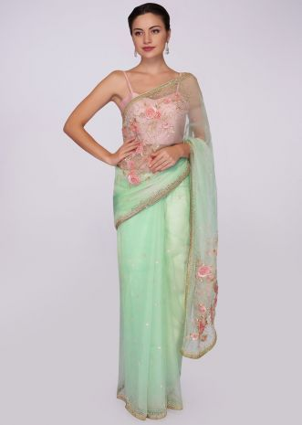 Pista green organza saree with floral embroidered pallo