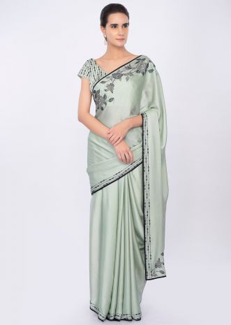 Pista green satin saree with kundan embroidery in floral motif only on kalki
