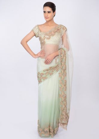 Pista organza saree with cut dana embroidered border only on kalki