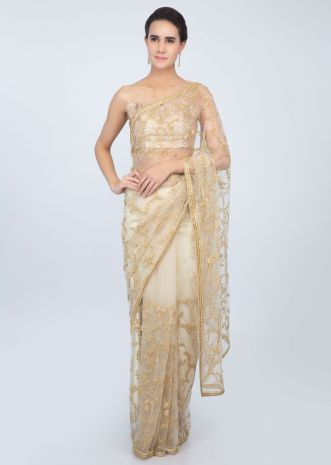 Powder cream tan sheer net saree in cut dana and moti jaal work only on kalki