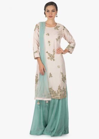Powder pink straight suit in silk with embroidered butti and hem