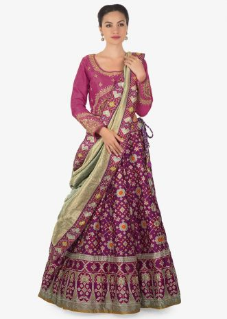 Purple lehenga matched with rani pink embroidered blouse in brocade dupatta only on Kalki