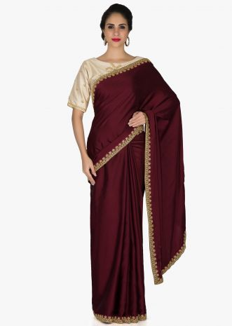 Purple Satin Saree and Cream Silk Blouse Adorned with Kundan, Zari and Zardosi only on Kalki