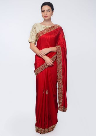 Rani pink satin saree embellished with cut dana embroidered butti and border