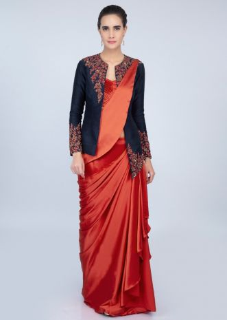 Rebel red ready plated satin saree with pleated strap blouse and navy blue raw silk jacket only on kalki