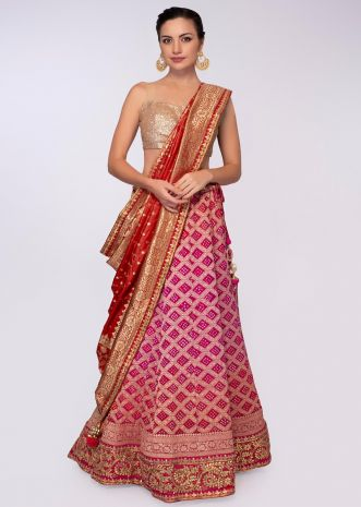 Red and pink shade bandhani print lehenga with red silk weaved dupatta