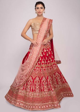 Red raw silk lehenga with pink net dupatta and unstitched red blouse
