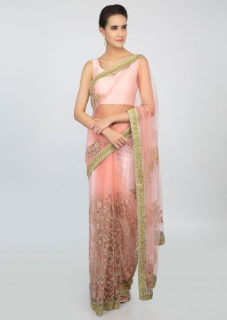 Rose pink sheer net saree with floral embroidered lower bottom and pallo only on kalki
