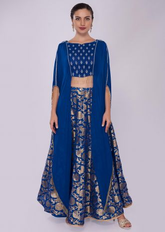 Royal blue brocade lehenga paired with long fancy crop top with fancy cape