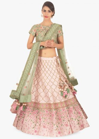 Sage green floral embroidered blouse paired with creamish pink lehenga and off white net dupatta