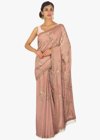 Salmon peach resham embroidered saree with fancy tassel border
