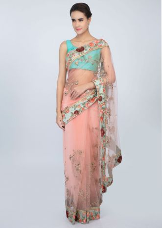 Salmon Peach sheer net floral jaal embroidered saree with contrasting pista green border only on kalki