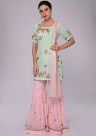 Sea green embroidered suit with pink sharara and net dupatta