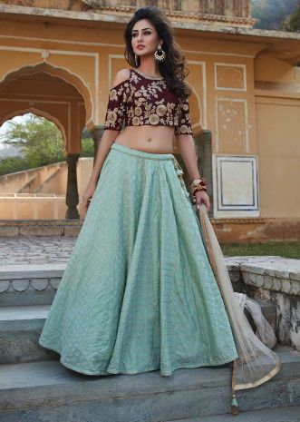 Turq green lehenga with burgundy crop top blouse in resham and zari work only on Kalki