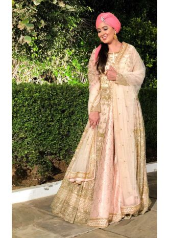 Light peach raw silk lehenga paired with long embroidered net jacket and dupatta