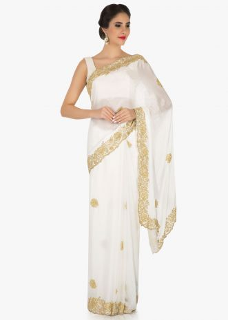 White georgette saree embellished in cut dana embellishments only on Kalki
