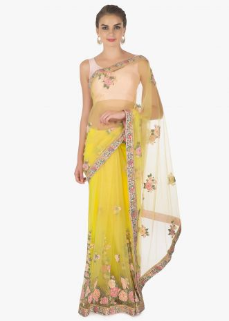 Yellow net saree in 3D flower with velvet patch