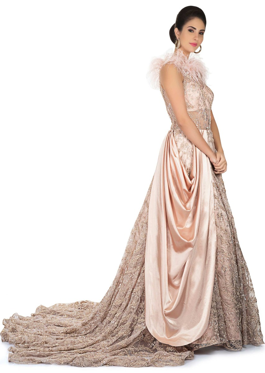 77e6a37b69bd Flushed pink gown with halter neckline and long trail only on Kalki