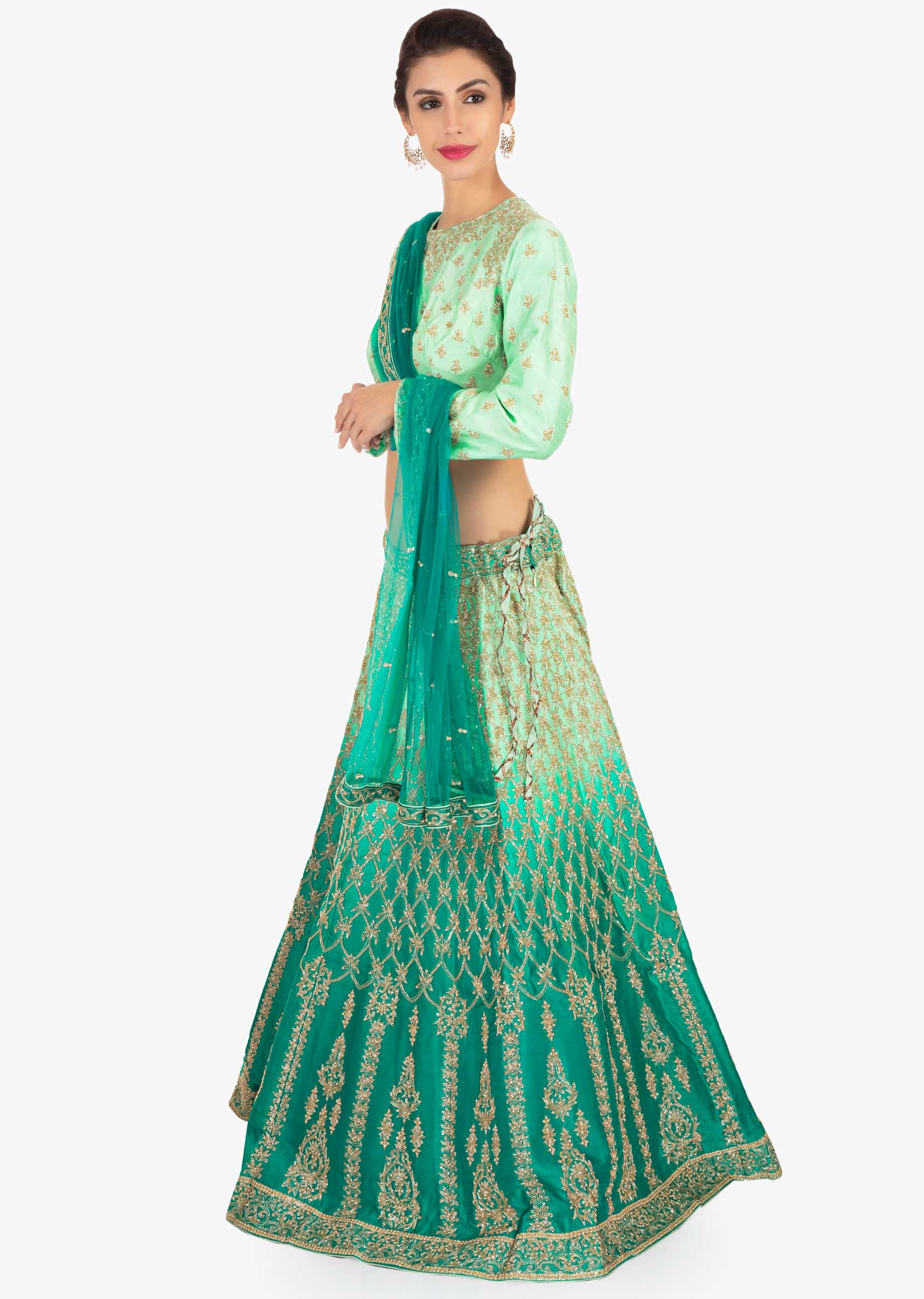 813ee82ced6664 Green shaded lehenga paired with mint green blouse and matching net dupatta  only on Kalki