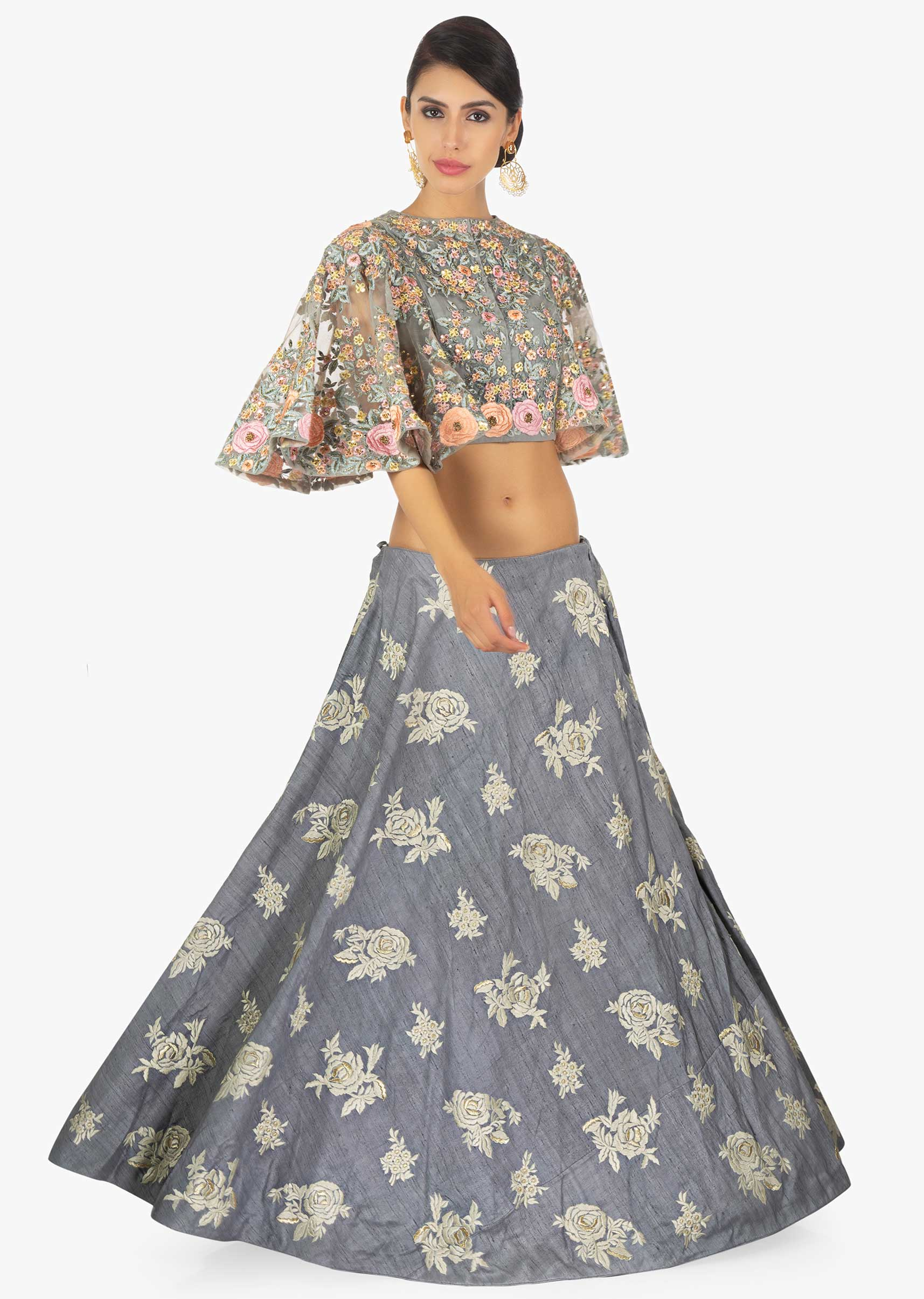 ee7677519e393a Grey net blouse with fancy cape sleeves paired with resham embroidered skirt  only on KalkiMore Detail