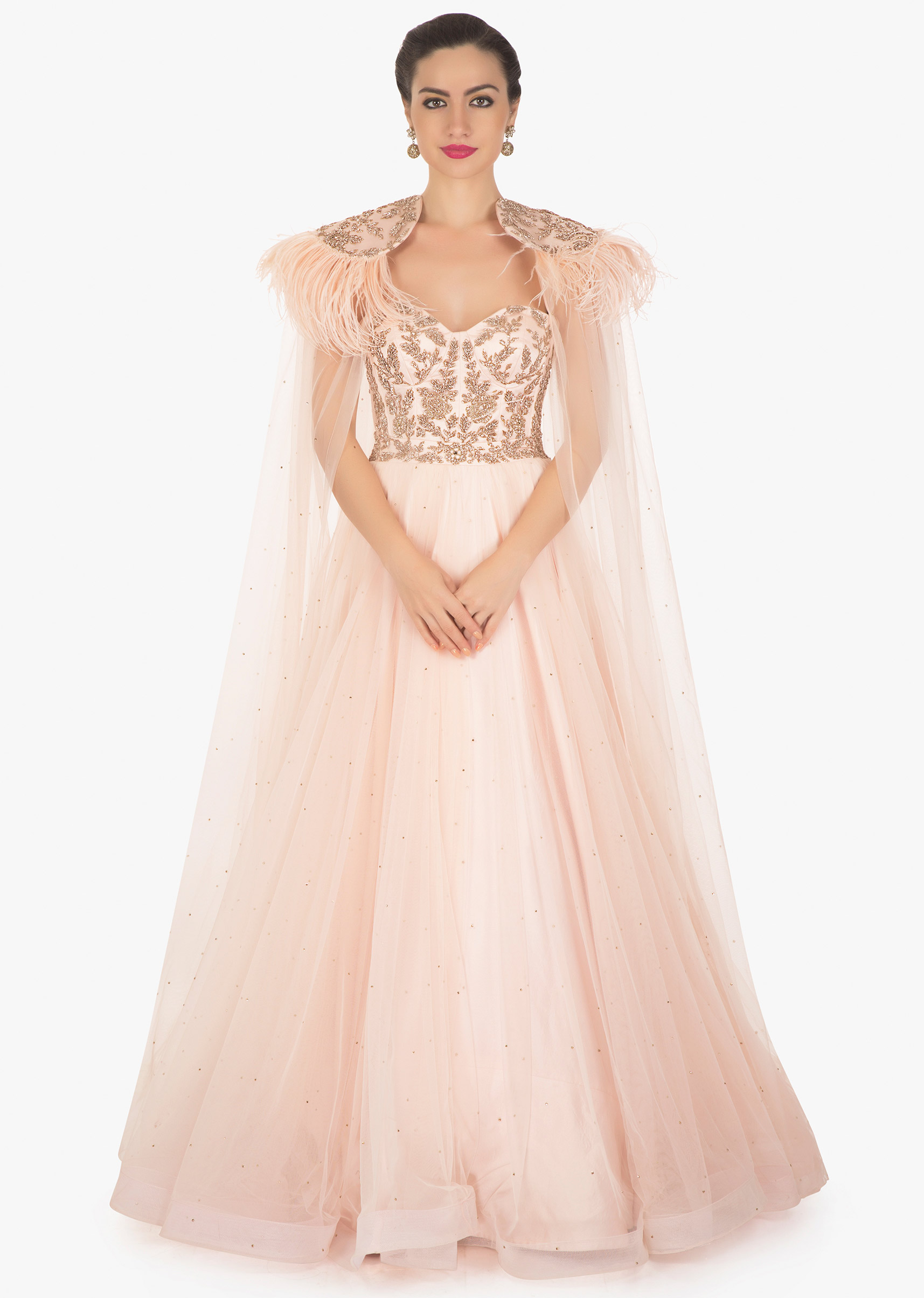 a5326f11169 Ice pink corset gown in net with fancy cape highlighted in feathers only on  Kalki