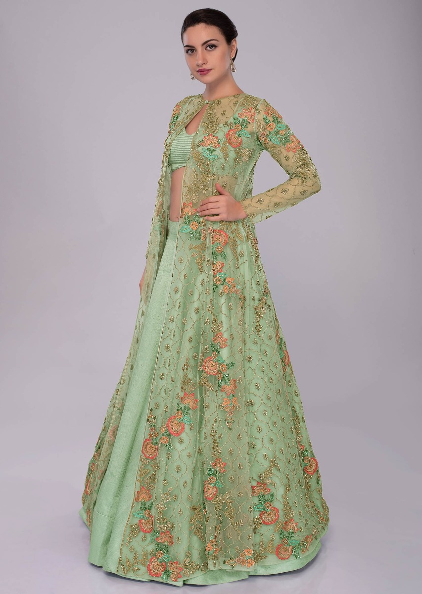 bede2e93e50011 Irish green raw silk skirt and blouses paired with long net embroidered  jacket only on Kalki