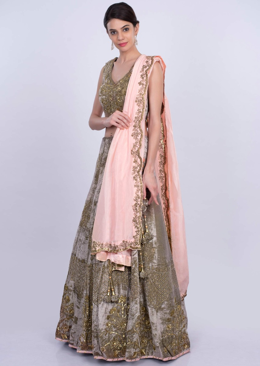 8fad423ee5 Mauve green heavy velvet lehenga set with salmon pink silk dupatta only on  Kalki