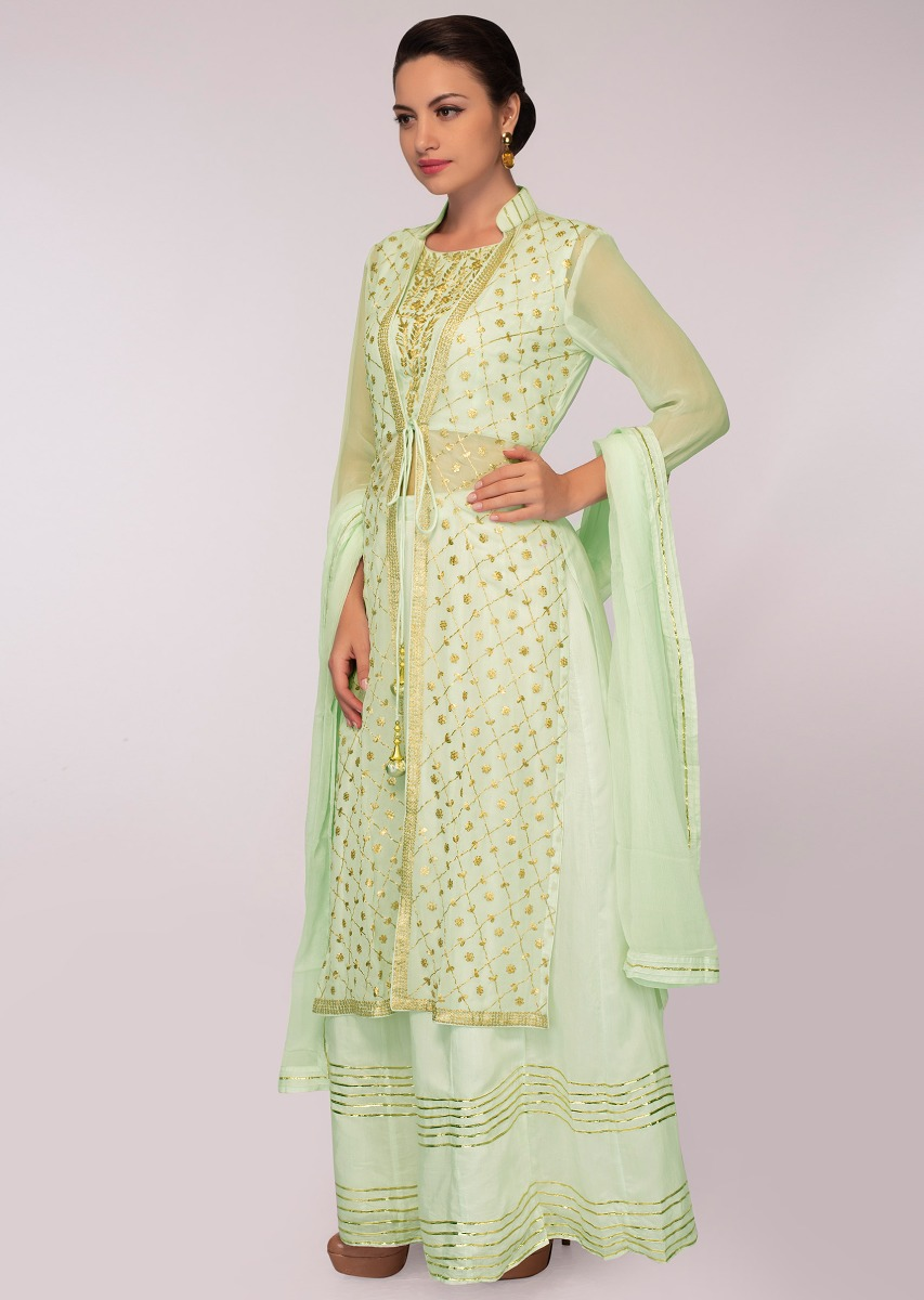 5bea78eee17060 Mint green cotton skirt paired with embroidered long jacket and matching  chiffon dupatta only on Kalki