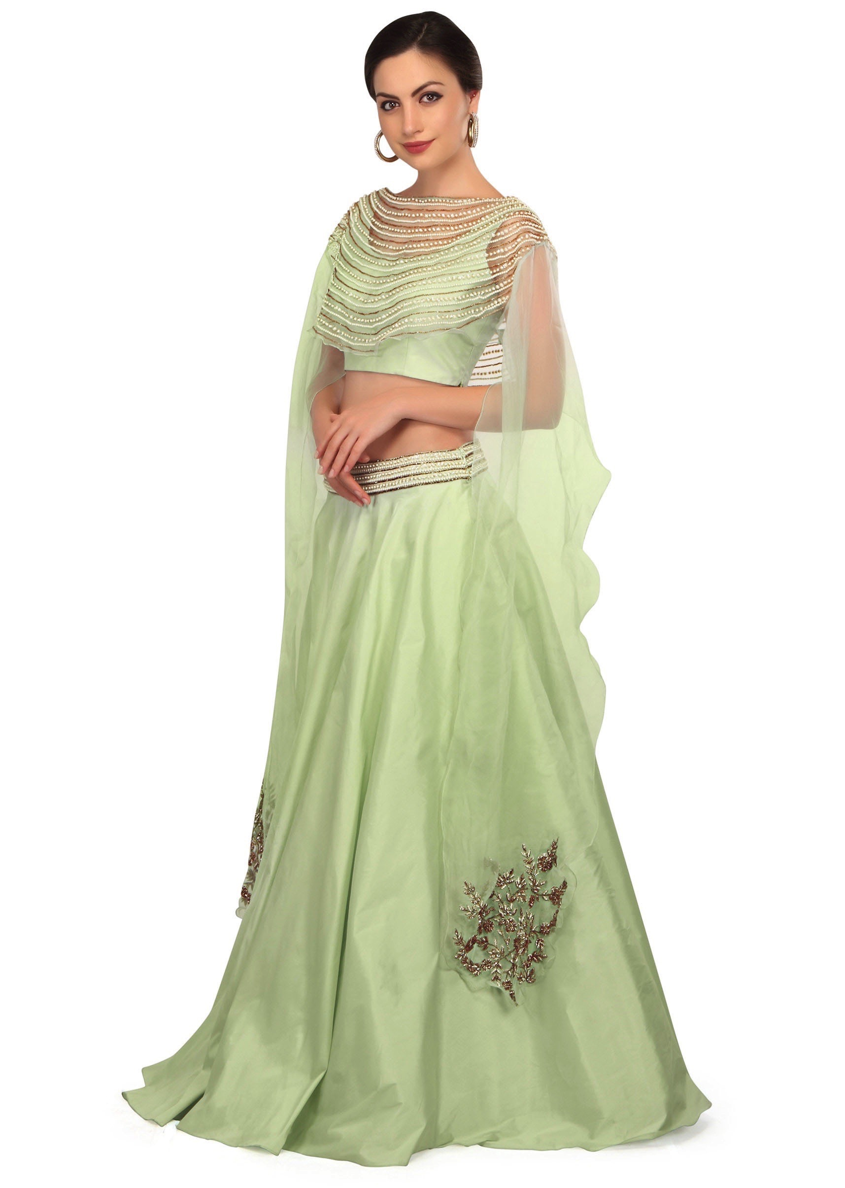 bca66fc3b12af9 Mint green lehenga with fancy embroidered cape blouse only on Kalki