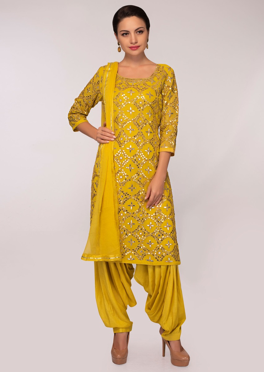 96c8d0676 Mustard jaal embroidered georgette suit with patiala pant and chiffon  dupatta only on Kalki More Detail