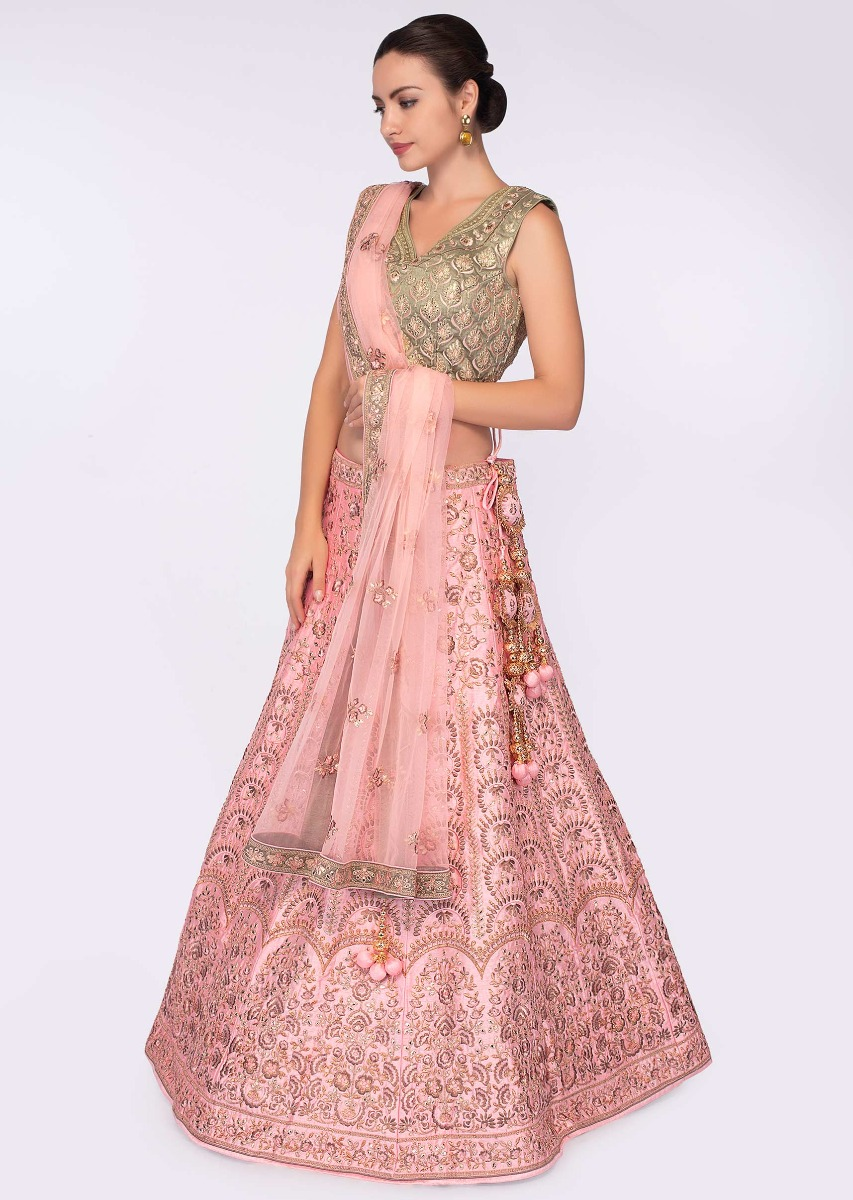 Olive Green Blouse Paired With Pink Heavy Embroidered Lehenga And