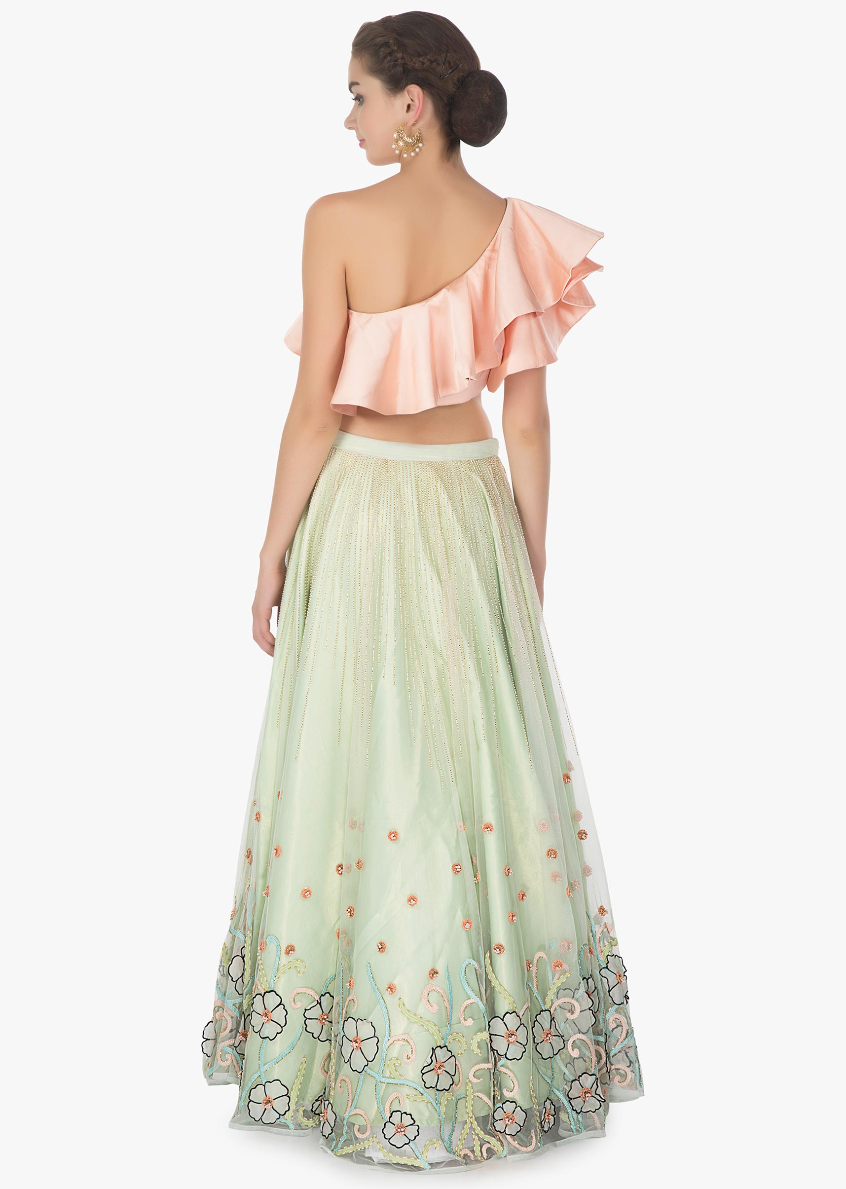 a8b83e5a4d374 One shoulder ruffled peach crop top paired with Pista green net skirt in 3  D flowers only ...
