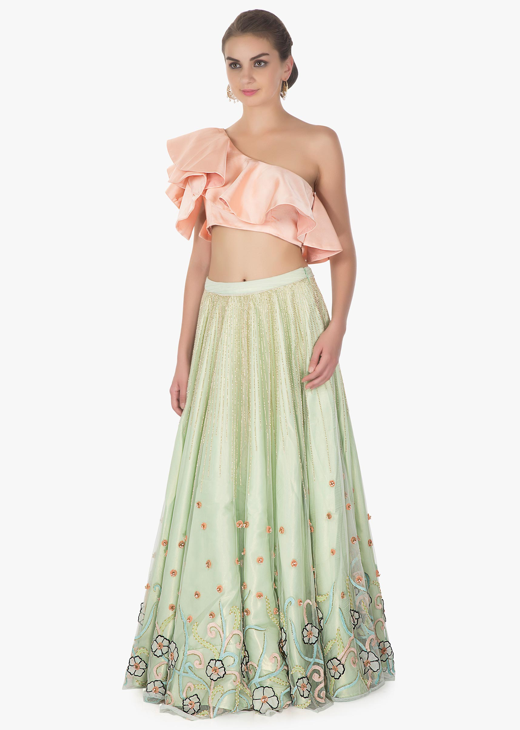 f2c07239efc42 One shoulder ruffled peach crop top paired with Pista green net skirt in 3  D flowers only on kalkiMore Detail