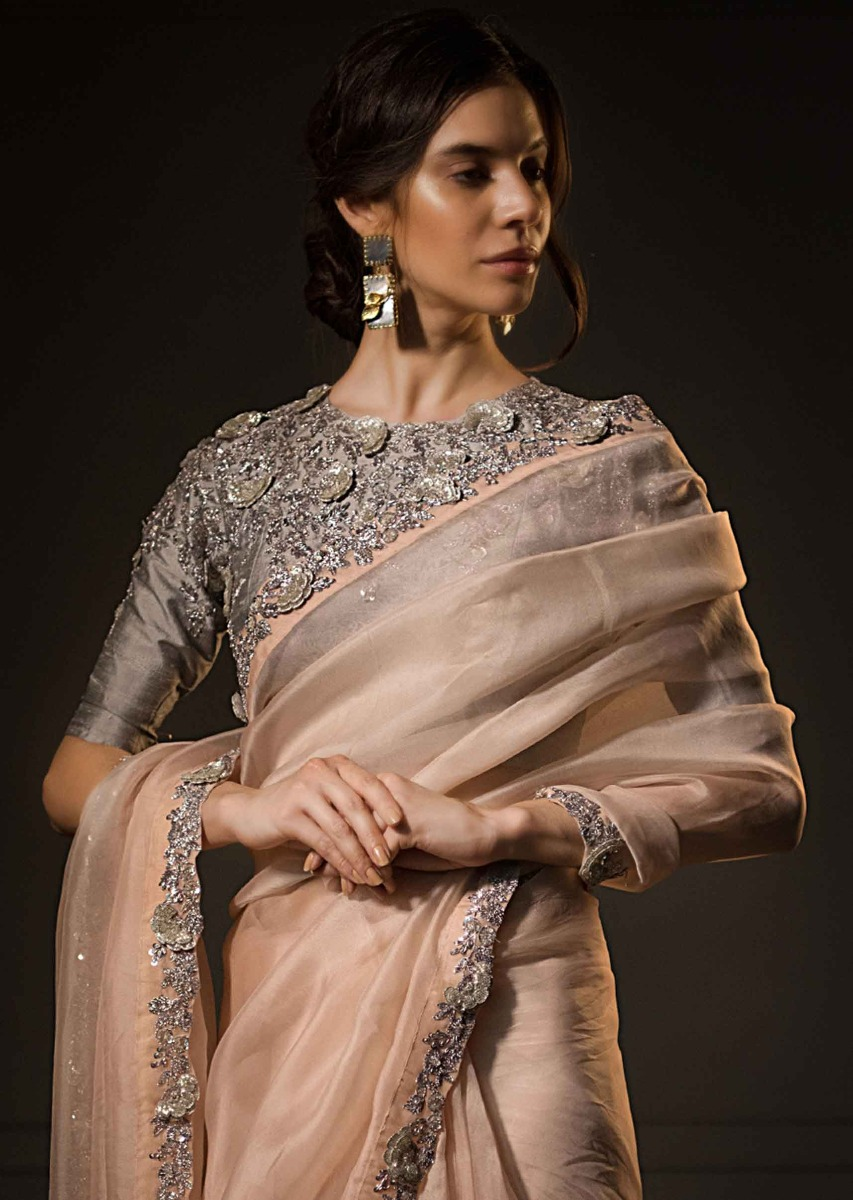 bcd4be74e9 Pastel peach organza saree with contrasting grey blouse only on kalki