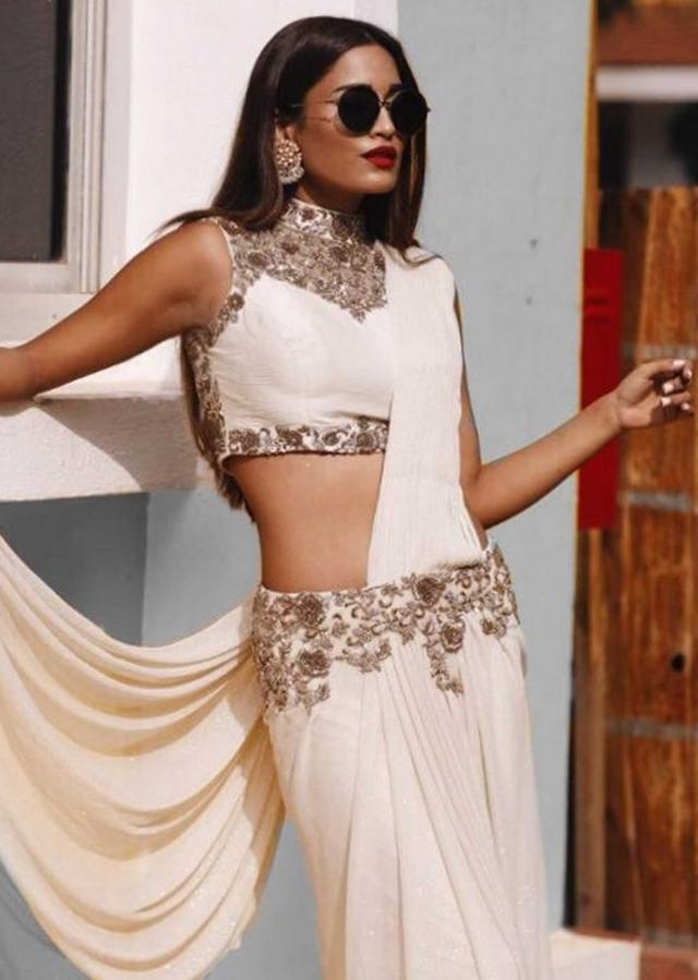 Off white saree gown adorn in zardosi and pearl work only on Kalki