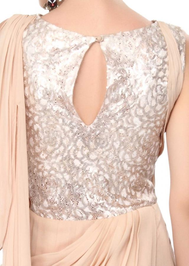 Beige saree gown enhanced in sequin embellished bodice only on Kalki