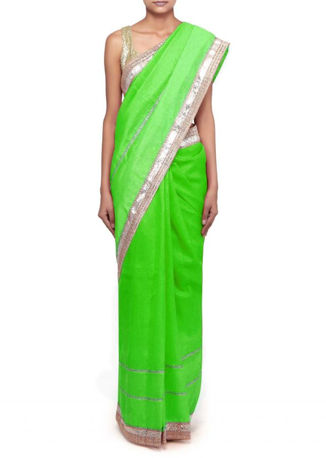 Green saree featuring in lace border only on Kalki