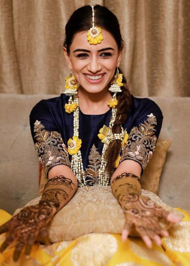 Smriti Khanna in Kalki chrome yellow lehenga and navy blue crop top