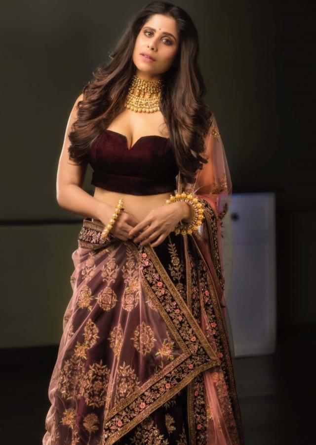 Wine velvet embroidered lehenga matched with pastel pink dupatta only on Kalki