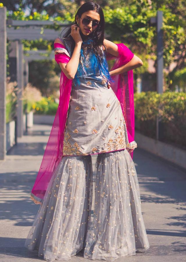 Grey sharara suit feautring in raw silk embellished in zari work in flroal motif only on Kalki
