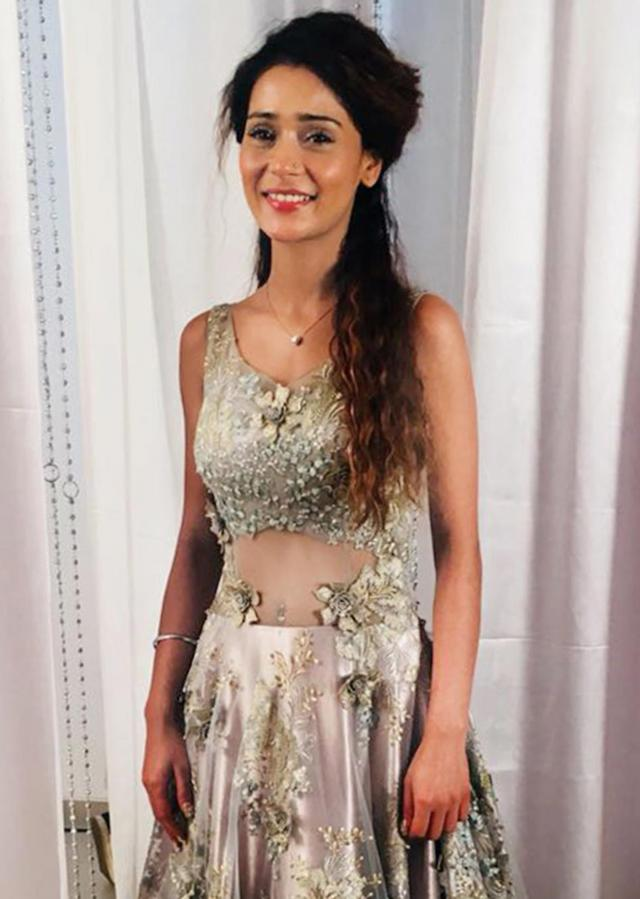 Sara Khan in Kalki silver net gown adorned with embroidered floral motifs only on Kalki
