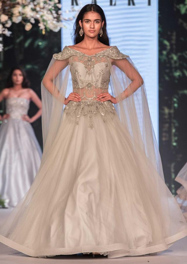 Light grey off shoulder gown in net with embroidered bodice only on Kalki