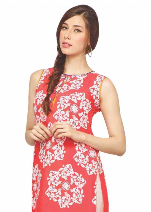 Coral kurti adorn in abstract print and fancy button only on Kalki