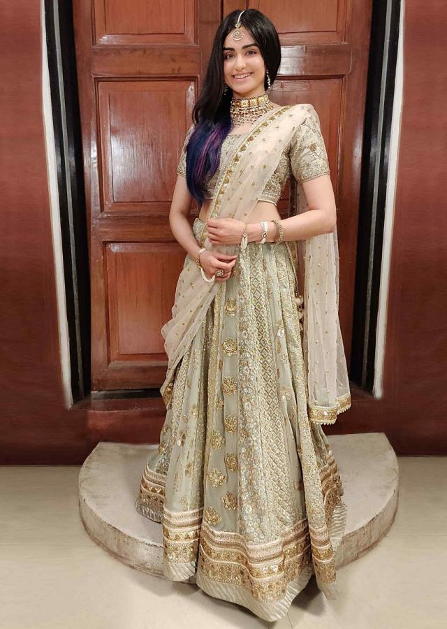 Adah Sharma in kalki pista green heavy embellished lehenga set with contrasting peach net dupatta