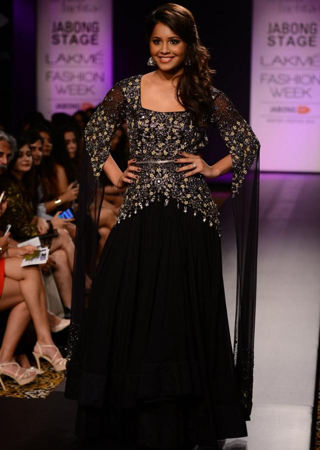 Model walks the ramp in black bodice and sleeve embellished gown for Arpita Mehta