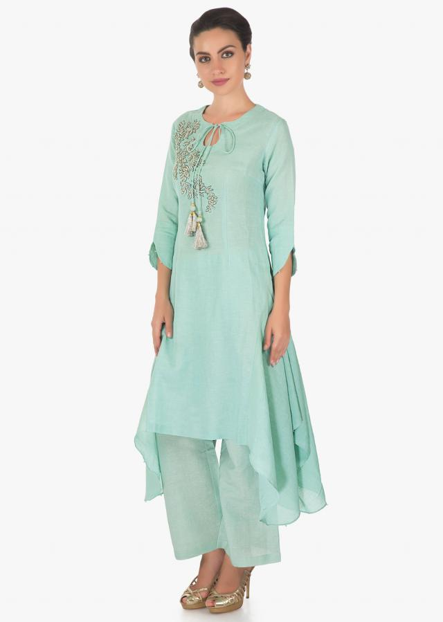 Asymmetric mud green cotton kurti and pants embellished with zari and moti work only on Kalki
