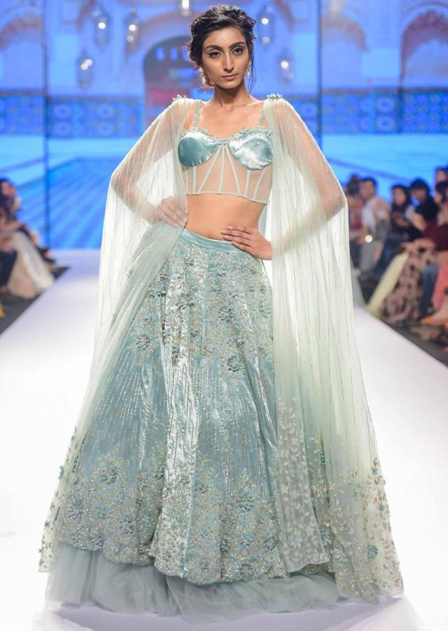 Aviary blue embroidered velvet lehenga paired with matching corset with attached draped dupatta only on Kalki