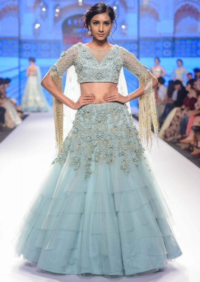 Aviary blue multi layered net lehenga set adorn with 3 D embroidered flowers and veils only on Kalki